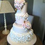 کیک عروسی چهار طبقه گل برجسته زیبا