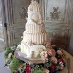 کیک پنج طبقه زیبا با طرح گلستان و قفس