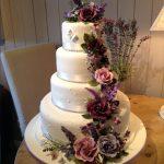 کیک عروسی چهارطبقه گل برجسته رنگی